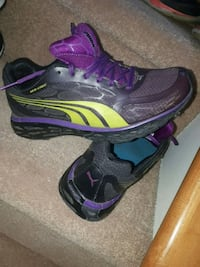 pair of black-and-purple Nike running shoes Calgary, T2Y 4S7