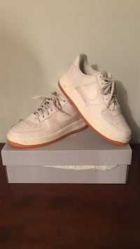 pair of white Nike Air sneakers on box