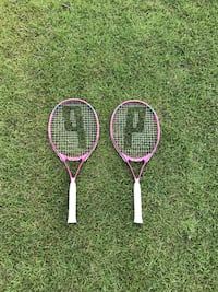 two white and pink tennis rackets Myrtle Beach