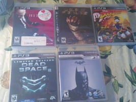 five Sony PS3 game cases