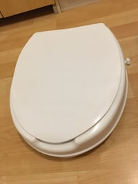 "Raised toilet seat with lid, by 2"", new - $30  Mississauga, L5L 5P5"