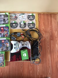 white Xbox 360 console with controllers and game cases Red Deer, T4P 3A8
