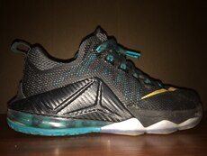 black and green mesh lace up basketball shoe