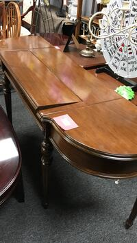oblong brown wooden dining table
