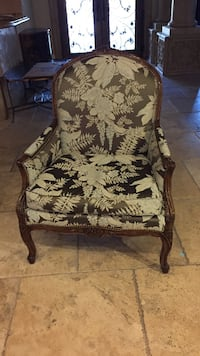 Black and white floral padded armchair