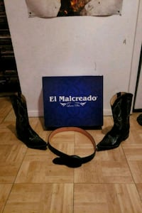 pair of black El Malcreado leather deep scallop pointed toe chunky heeled mid-calf cowboy boots with belt and box San Antonio, 78204