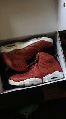retro red-and-white Air Jordan 6's in box