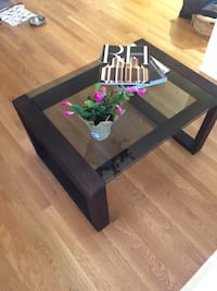 Antique refinished brown wooden coffee table with smoked glass