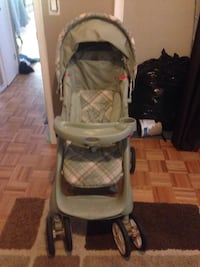 Baby's green and grey graco stroller