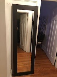Full Length Mirror. Dark brown faux wood frame. In great condition.  Toronto, M6C 2X7