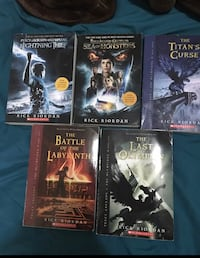 five assorted books by Rick Riordan