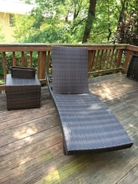 Outdoor Brown Wicker Chaise Lounge Chair and small side table. Vienna