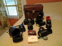 35mm camera (non-digital) w/misc. lens & leather bag