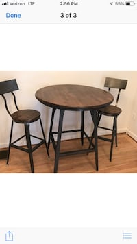 Round brown wooden table with two chairs Arlington, 22204