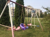 purple, pink, and gray swing playset