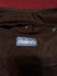 Brown women's purse brand is Clair's  Mineola, 75773