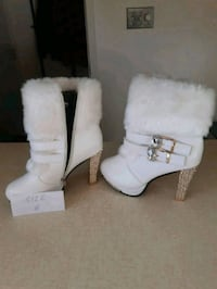 pair of white leather boots Edmonton, T5L 3A7