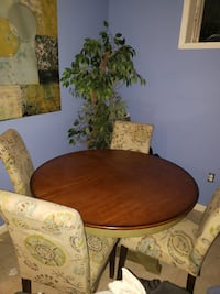 brown wooden table with chairs 17 mi