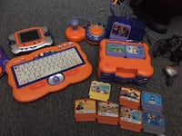 orange and blue assorted game console with cartridges Ottawa, K0A 1K0