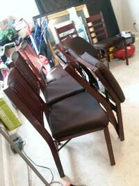 brown wooden framed black leather padded armchair Houston, 77020