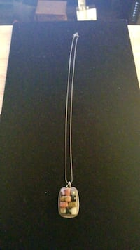 Sterling silver necklace with stone charm