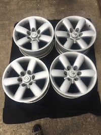 "Four Nissan Titan 18"" rims"