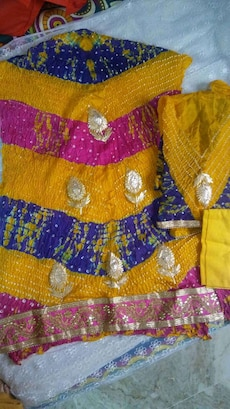 yellow, pink and black rhinestone textile