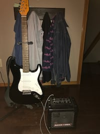 black and white stratocaster electric guitar with black Micro Cube guitar amplifier Winnipeg, R2G