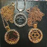 Chanel interchangeable disk necklaces  West Kelowna, V4T 1C3