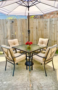 Almost new 5-piece outdoor patio glass dining set w opt umbrella /base