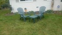 two gray plastic armchairs and table