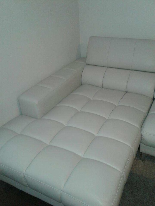 Used Tufted white leather sectional sofa for sale in Tampa - letgo