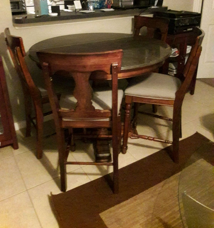 Photo Tall dining room table- rooms to go- marble tob- bought it for 1000.00