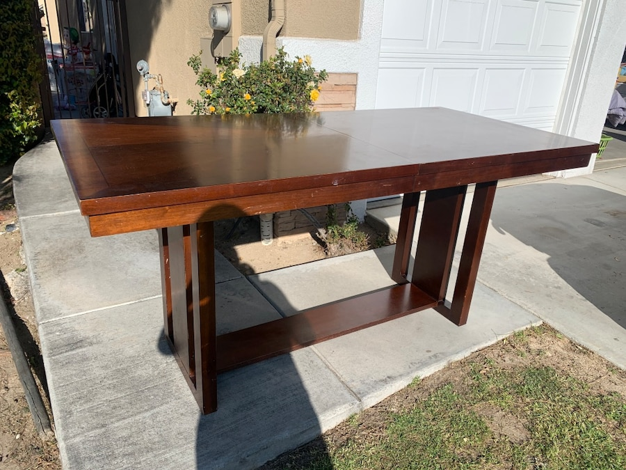 Photo Selling my excellent condition solid wood dinning room table no chairs