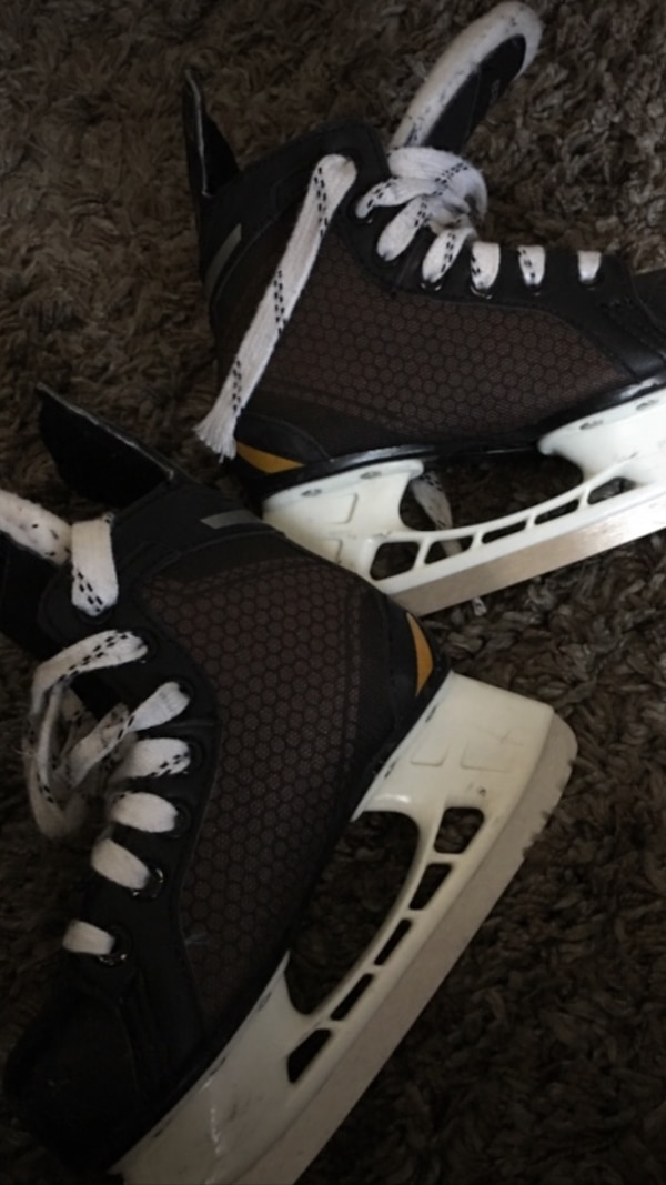 Hockey skates and gloves.  2e4d23ad-b210-43cc-8670-bfa32101619d