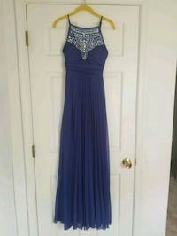 Floor length cobalt blue dress with bead accents