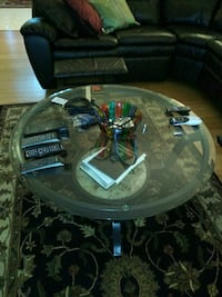 round black metal framed glass top table Seminole, 33772