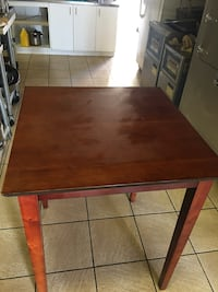 Rectangular brown wooden 30x30 restaurant table. two of them