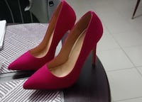pair of red suede pointed-toe pumps VANCOUVER