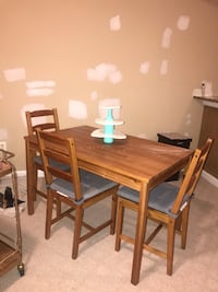 Wood table with chairs. Good condition Tysons