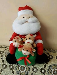 white and red bear plush toy London
