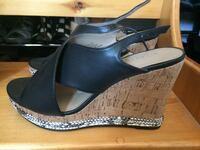 pair of black leather open-toe wedges Port Coquitlam, V3C 6E4