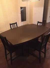 rectangular brown wooden table with chairs Ottawa, K2E