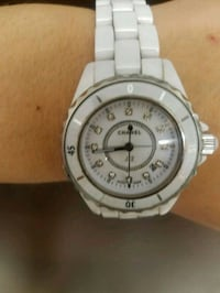 round white analog watch with silver link bracelet Edmonton, T6H 4J6