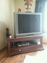 black flat screen TV with brown wooden TV stand Fort Wayne, 46818