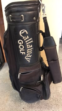 Black and white titleist golf bag, very good condition. Ready for some golfing!
