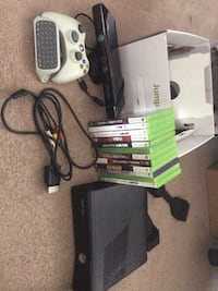 Black xbox 360 console with controller and game cases Ajax, L1Z 1K2
