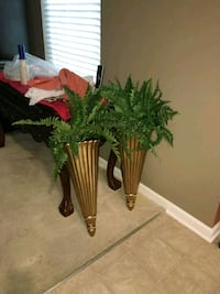 Two green faux plant with gold wall sconces Waldorf