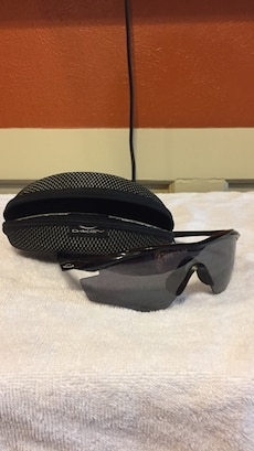 Black Oakley sunglasses w/ case