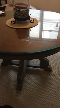 Round brown wooden dining table Arlington, 22206